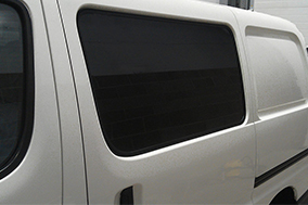 Nearside fixed privacy tint window.