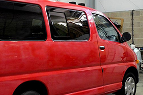 Offside privacy tint rear opening sliding window and rear quarter glass.